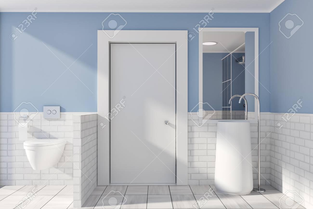 Blue And White Brick Bathroom Interior Idea. A Tiled Wooden Floor ...