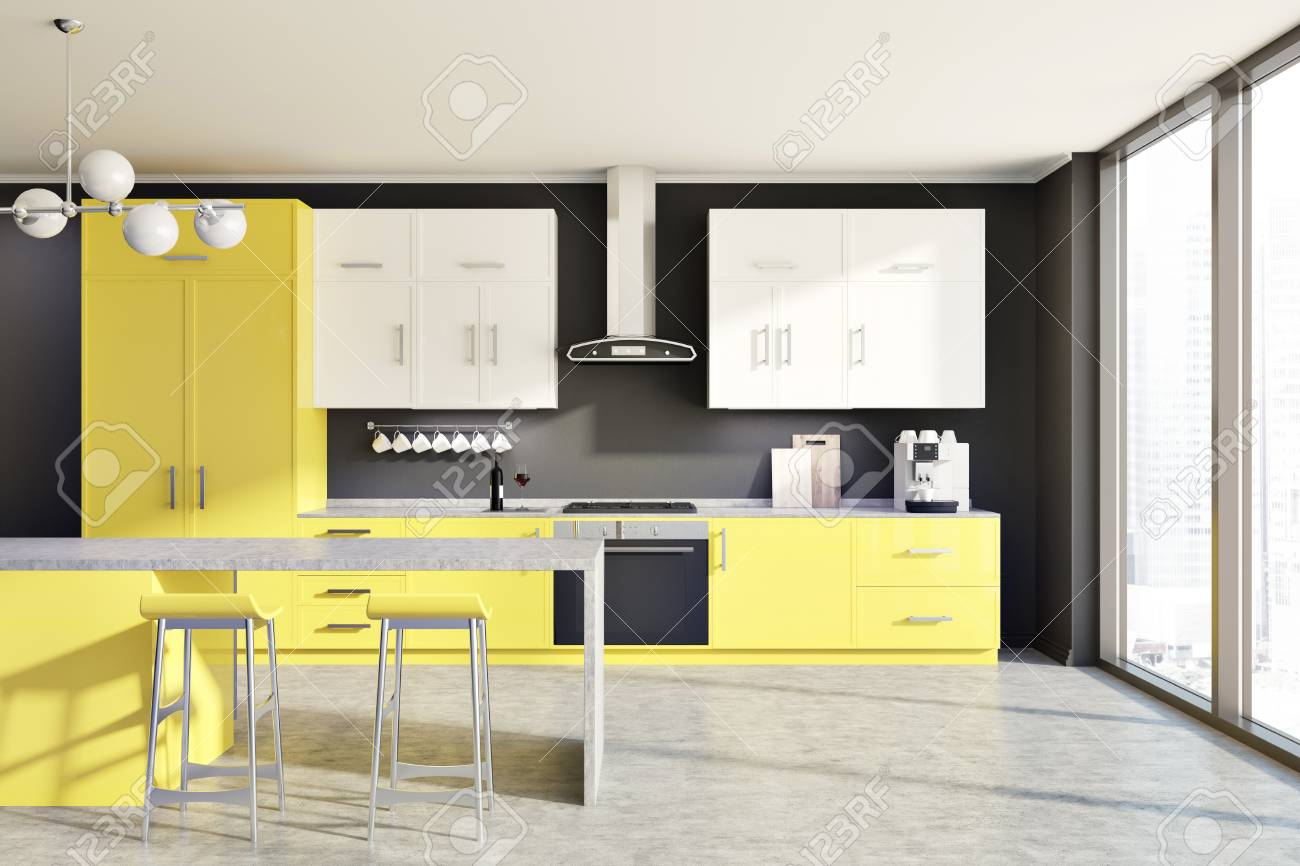 Modern kitchen interior with yellow and white counters a table and two stools black
