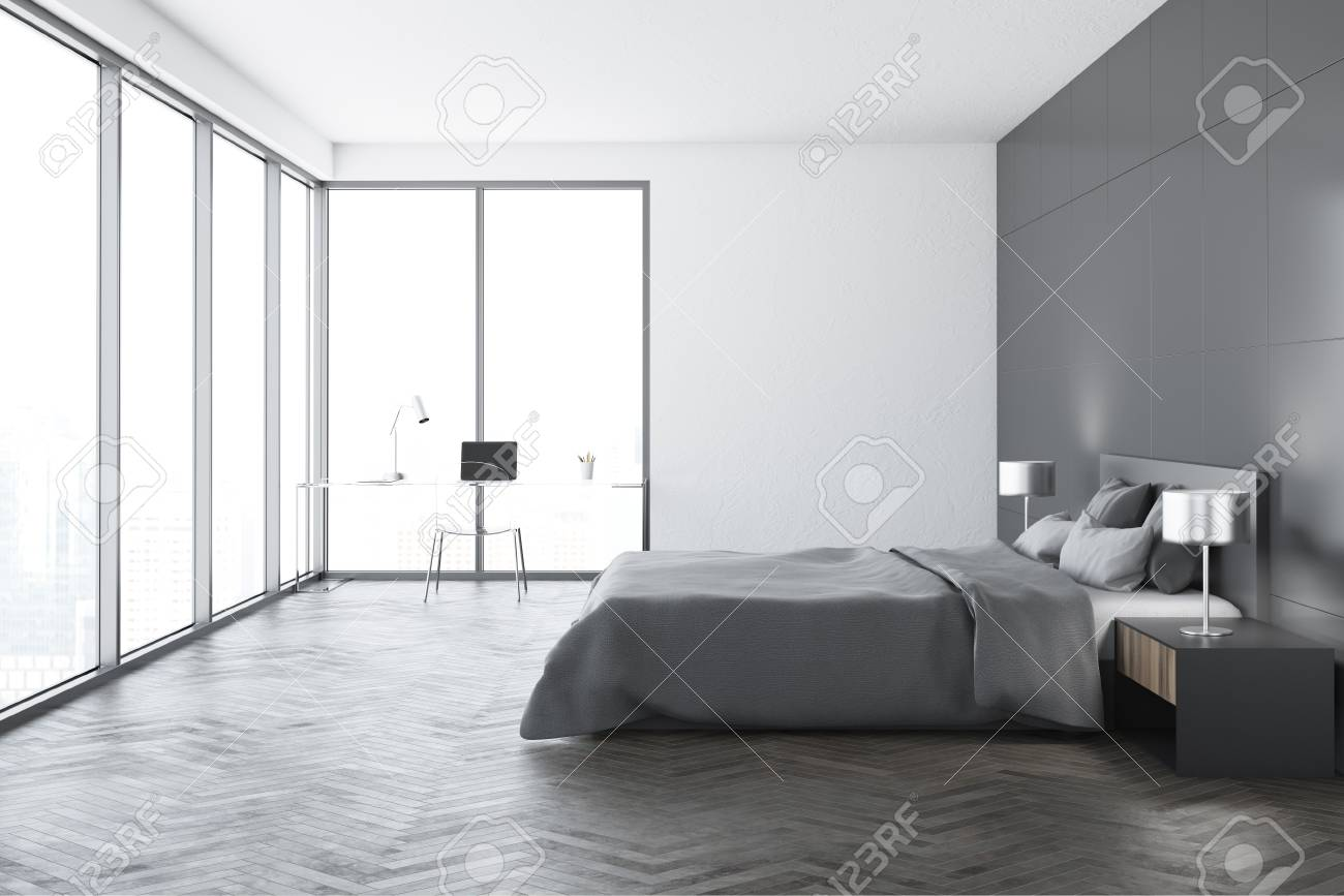 Modern bedroom interior with white walls, a concrete floor, a..