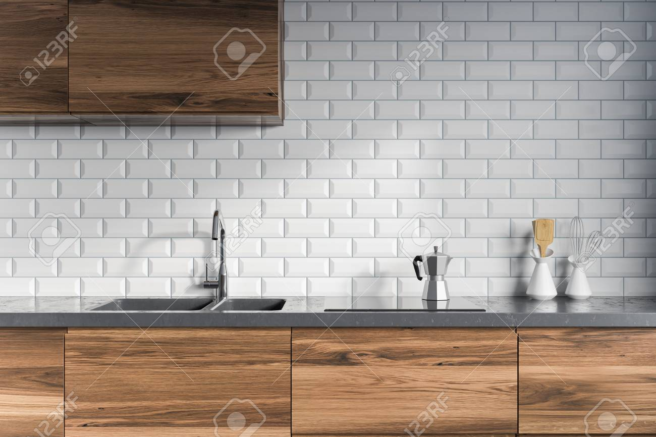 Modern Kitchen Interior With White Brick Walls Dark Wooden Countertops Stock Photo Picture And Royalty Free Image Image 98027099