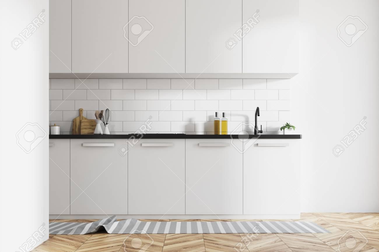 Modern Kitchen Interior With White Brick Walls, White Countertops ...