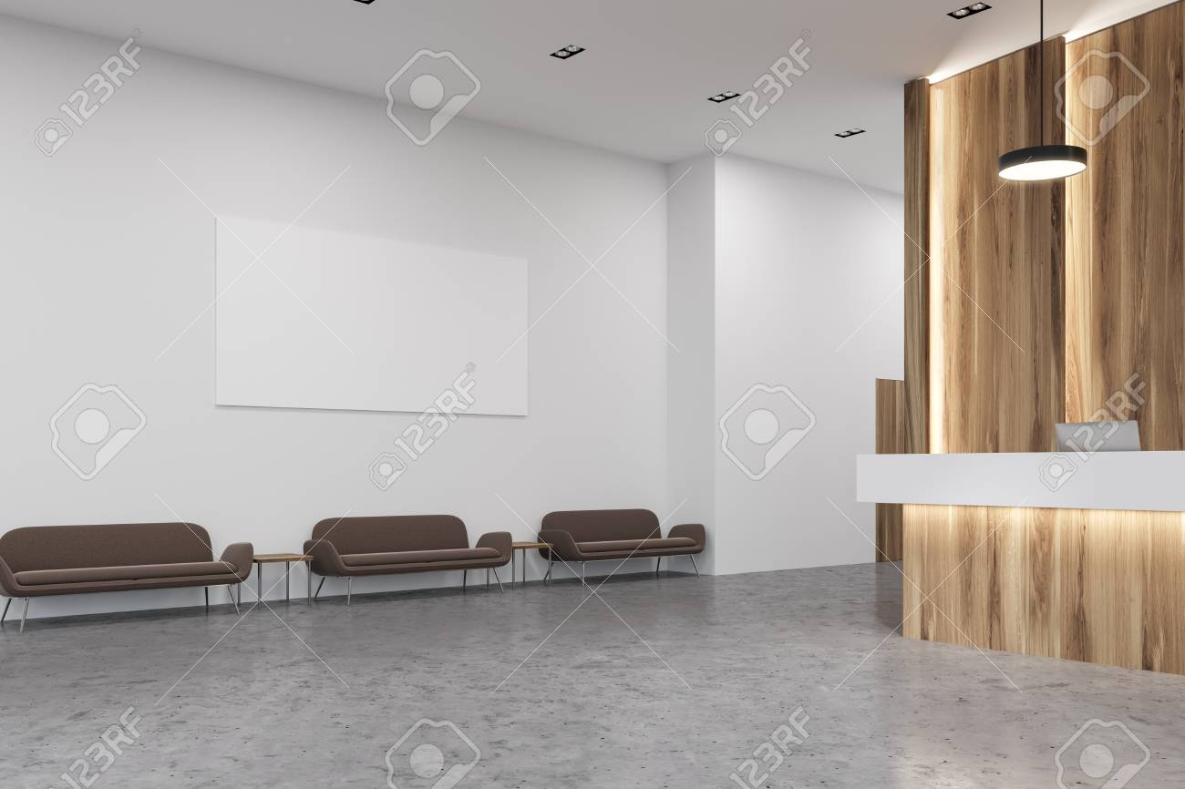 Wooden and white reception desk standing in a modern office hall..