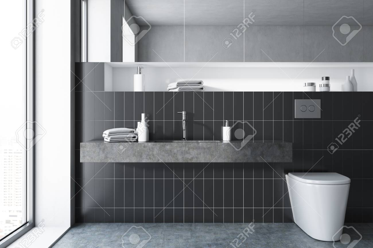 Black Tile Bathroom Interior With A Large Sink A Toilet And Stock - How long does it take to tile a bathroom