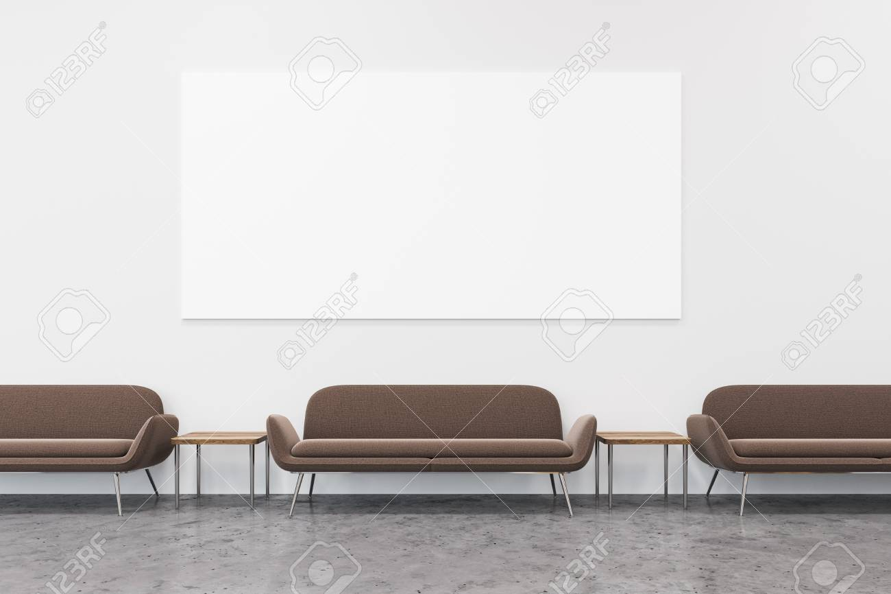 Modern Office Waiting Room With A Row Of Brown Sofas And A Large ...