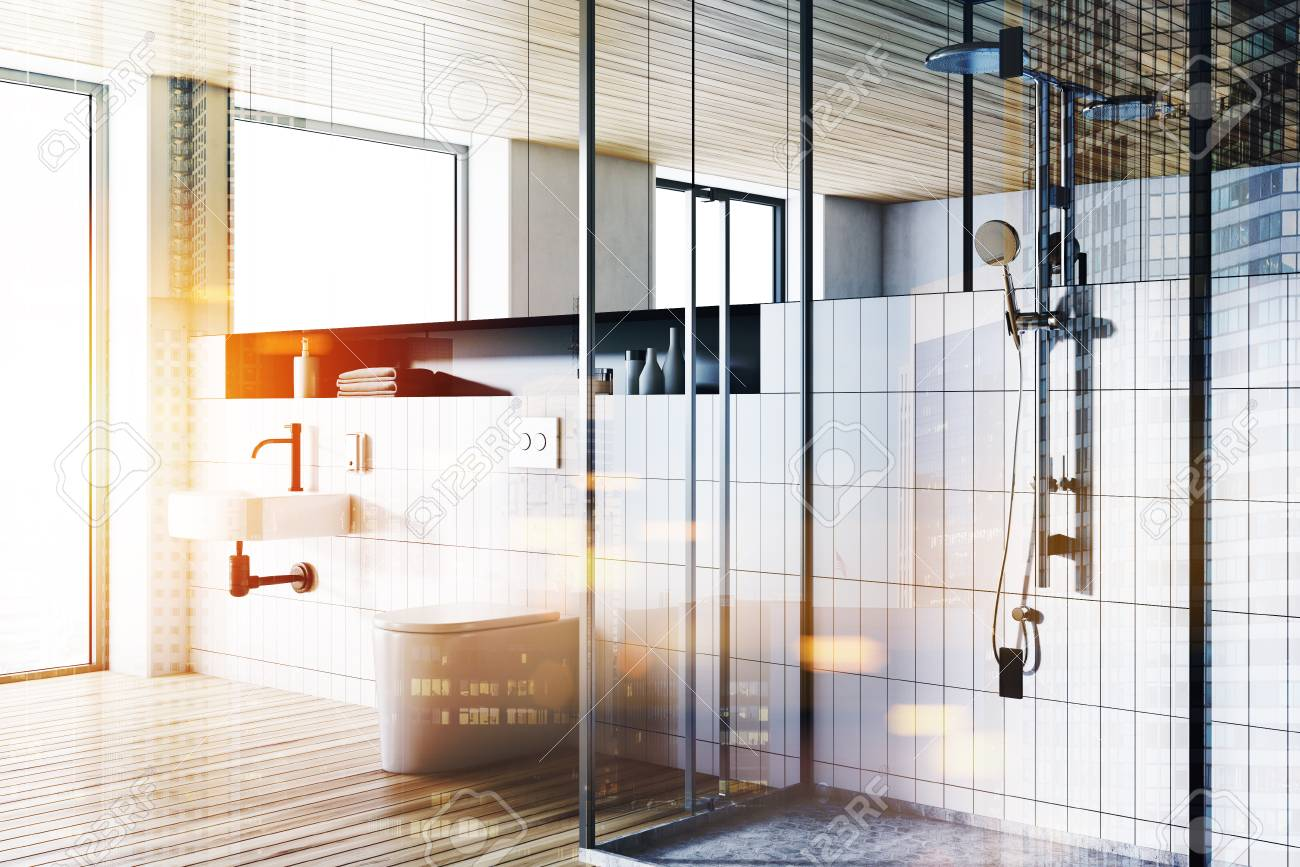 Corner Of A Modern Bathroom With White Tiled Walls, A Round Sink ...