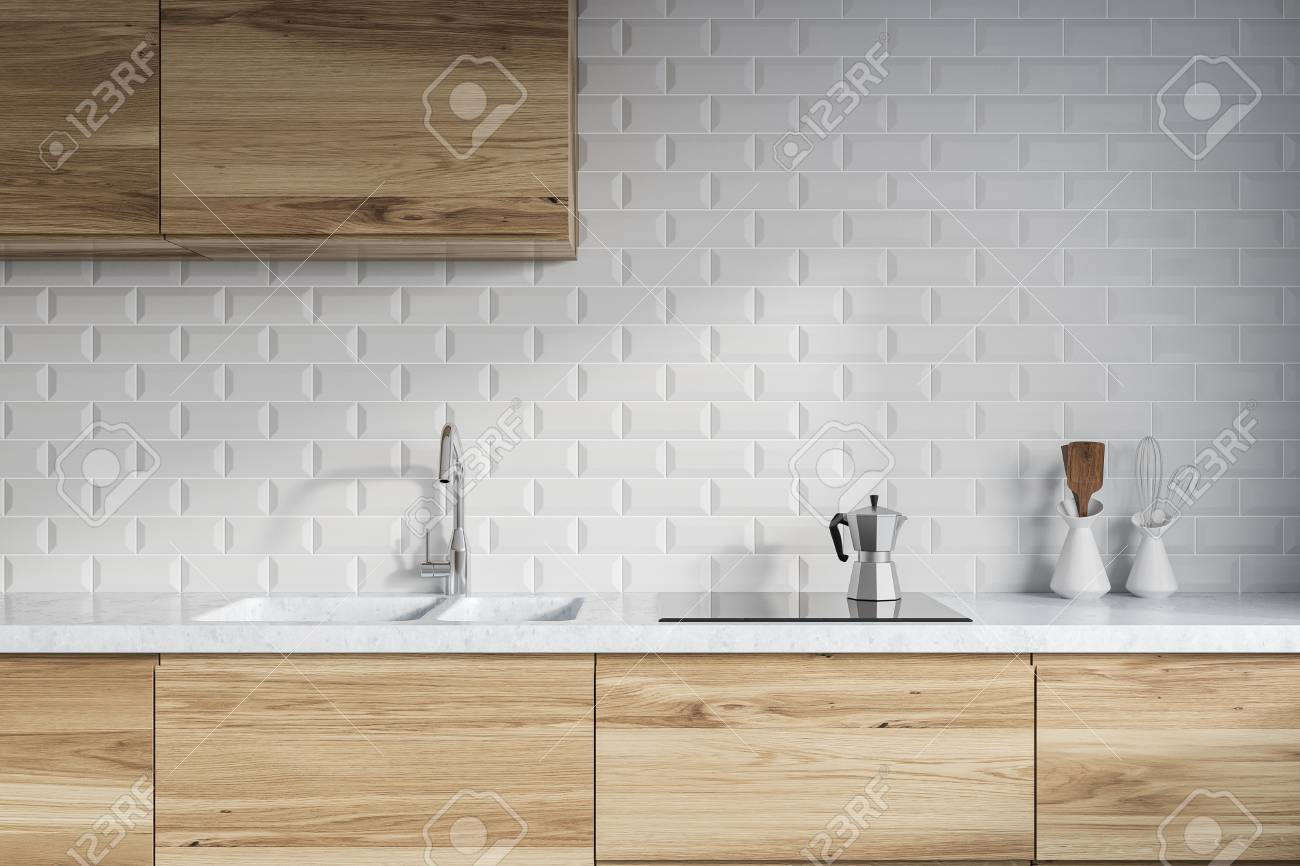 Modern Kitchen Interior With White Brick Walls Wooden Countertops Stock Photo Picture And Royalty Free Image Image 98422141