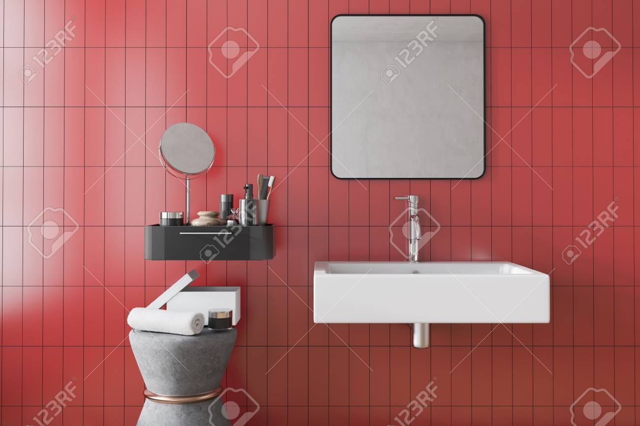 White Bathroom Sink With A Square Mirror Hanging Above It In Stock