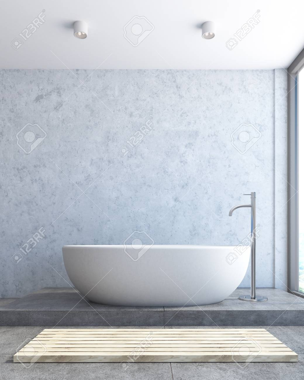 Close Up Of A White Bathtub Standing On A Concrete Floor Of A ...