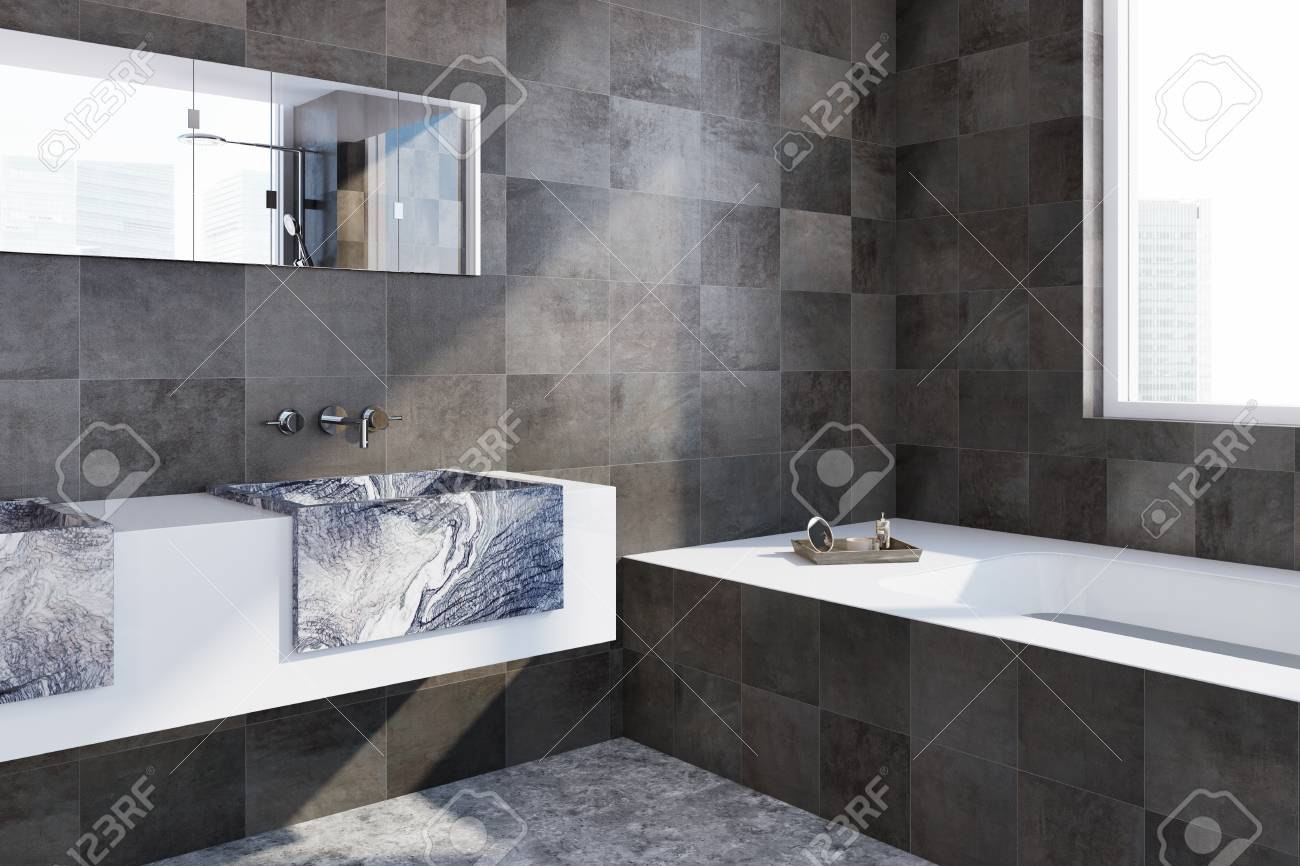 Corner Of A Bathroom With Black Tiled Walls, A Concrete Floor ...