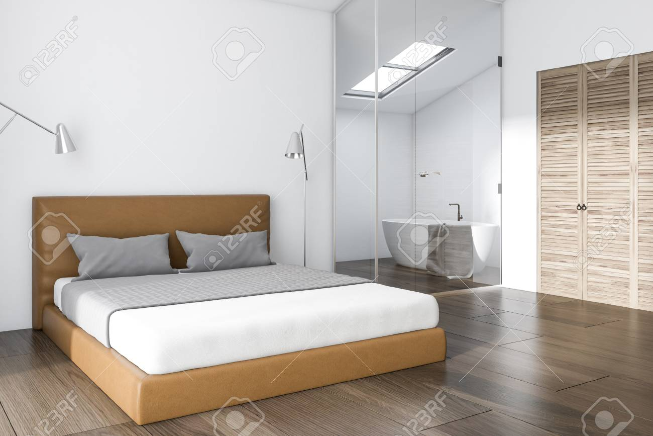 White Bedroom Corner With A King Size Bed And A Small Bathroom Stock Photo Picture And Royalty Free Image Image 100556792