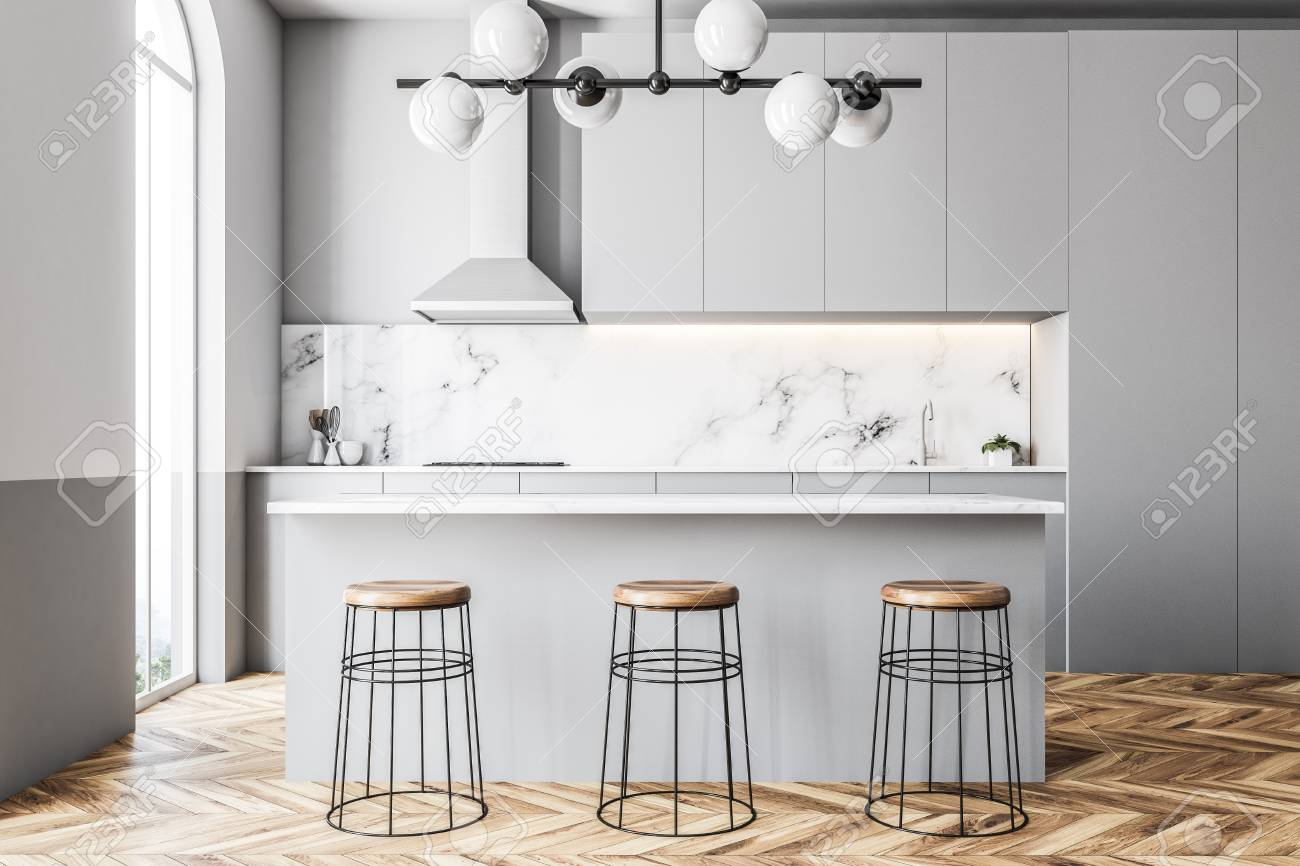 Gray And Marble Kitchen With Countertops A Bar And Stools Arched Stock Photo Picture And Royalty Free Image Image 101978507