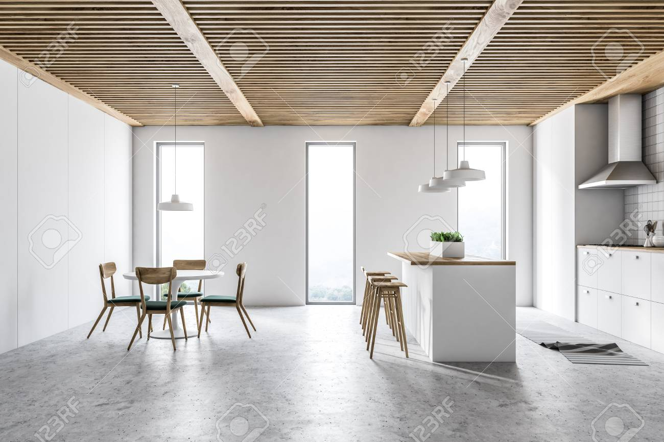 White Kitchen Interior With White Countertops A Table With Chairs