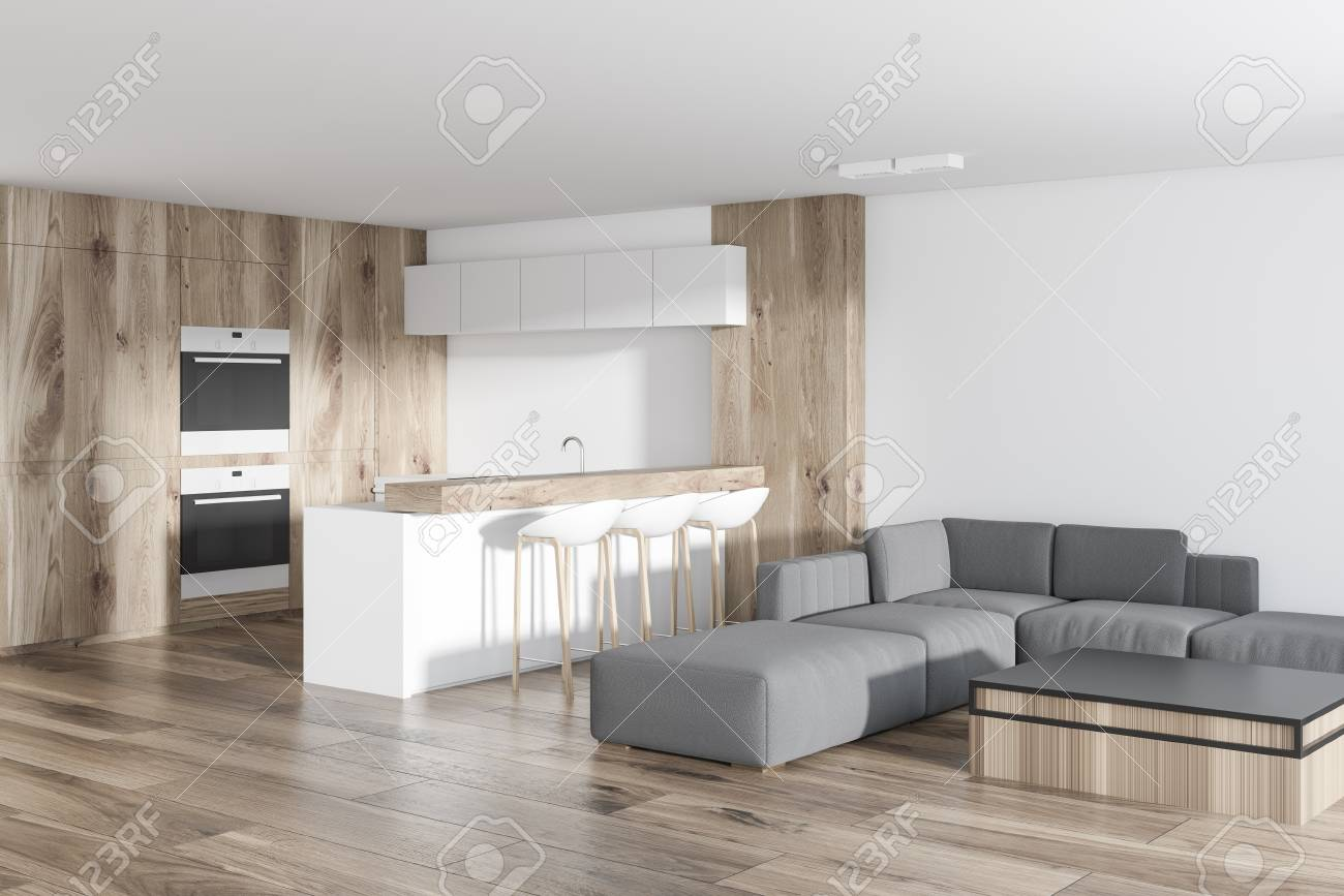 Studio apartment kitchen and living room corner with a wooden..