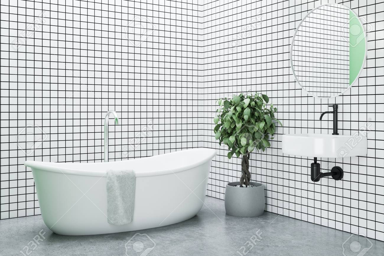 White Tiled Bathroom With A Concrete Floor, A White Bathtub And ...