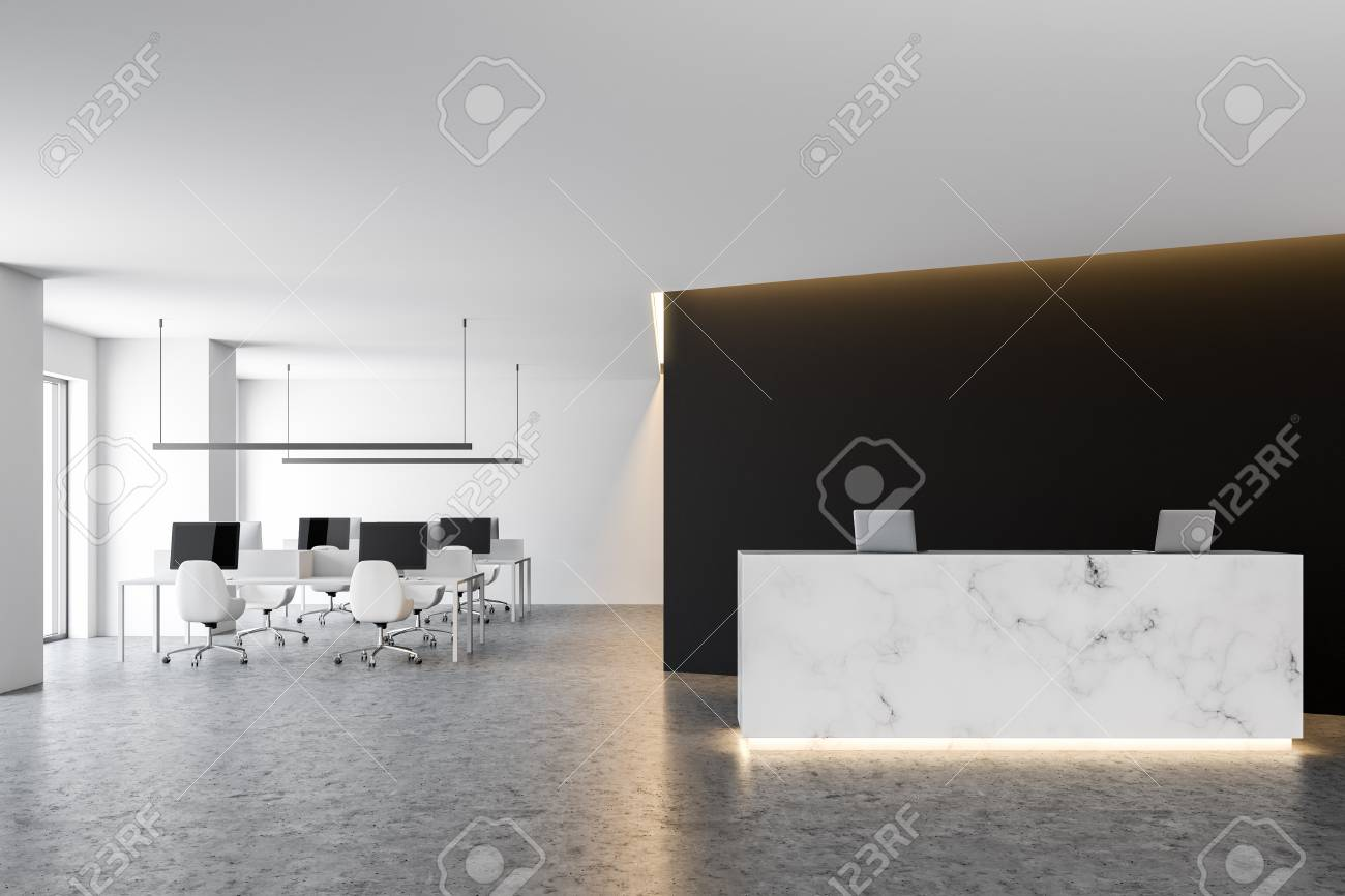 Marble Office Reception Table With Two Computers Standing In