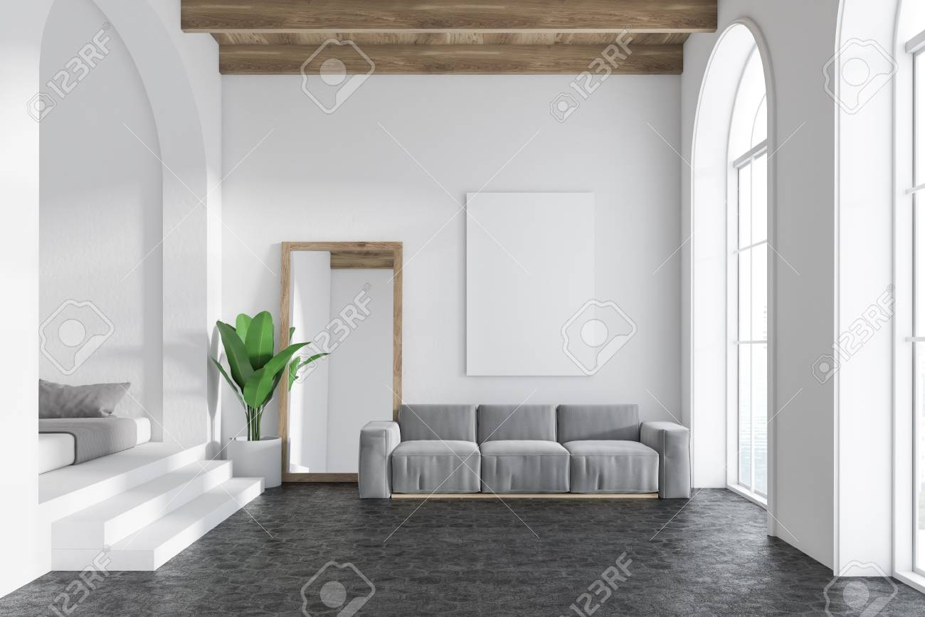 Gray sofa living room interior with white walls, arched windows,..