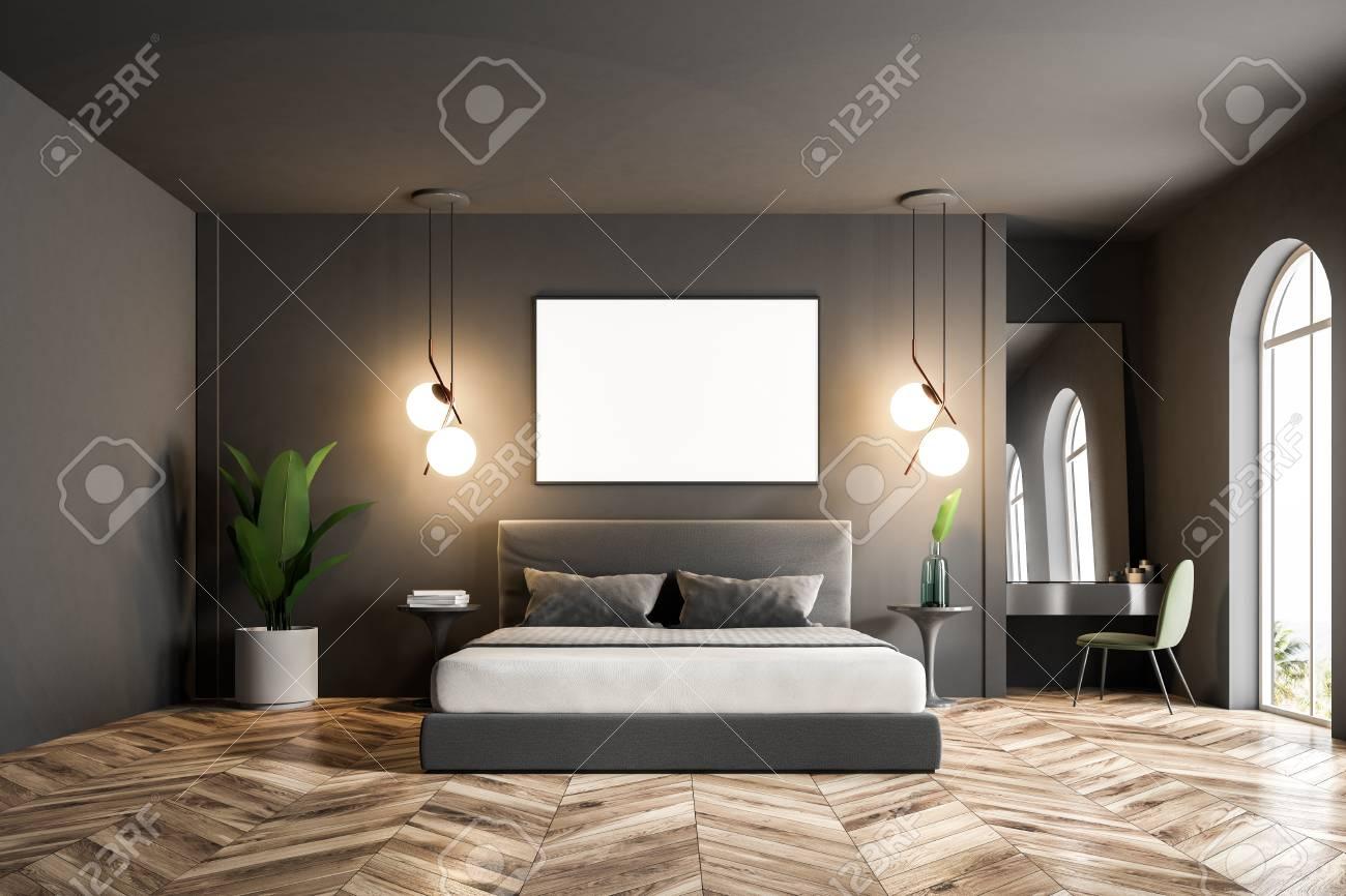 Modern bedroom interior with dark gray walls, a wooden floor,..