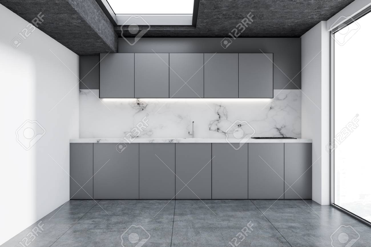 Modern Kitchen Corner With White Walls A Concrete Floor And Gray