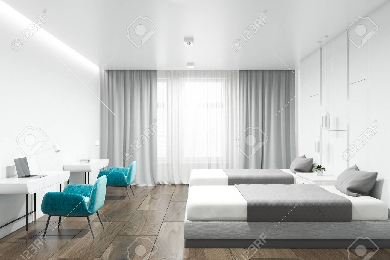 Hotel Suite Interior With White Walls A Wooden Floor Two Beds