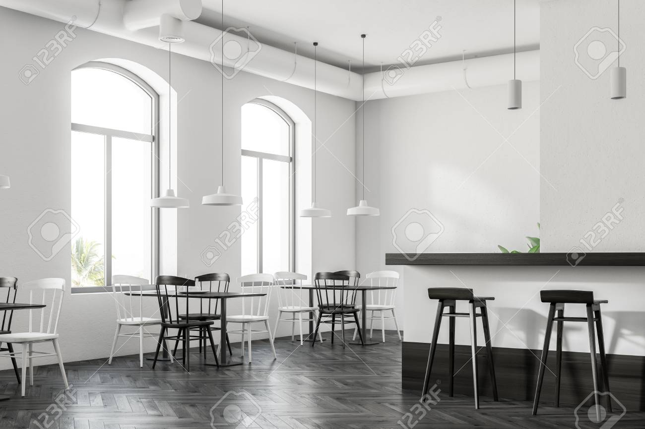 Arched Windows Cafe Interior With A Dark Wood Floor White Walls
