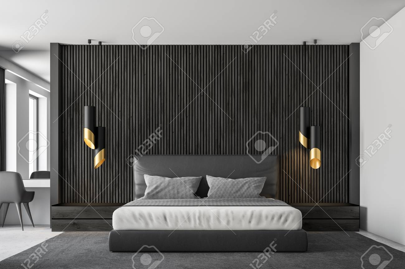 Black wood walls master bedroom interior with a concrete floor,