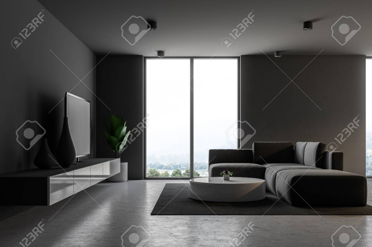 Banque dimages gray modern living room interior with loft windows a concrete floor a gray sofa with a round coffee table and a tv set