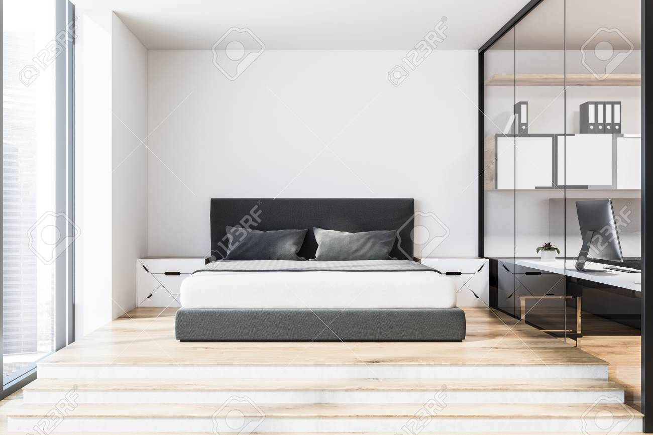 Front View Of A Bedroom And Home Office Interior With White Walls, A Wooden  Floor