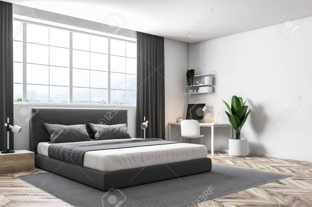 Master Bedroom Corner With White Walls, A Carpet On A Wooden Floor And A  Double