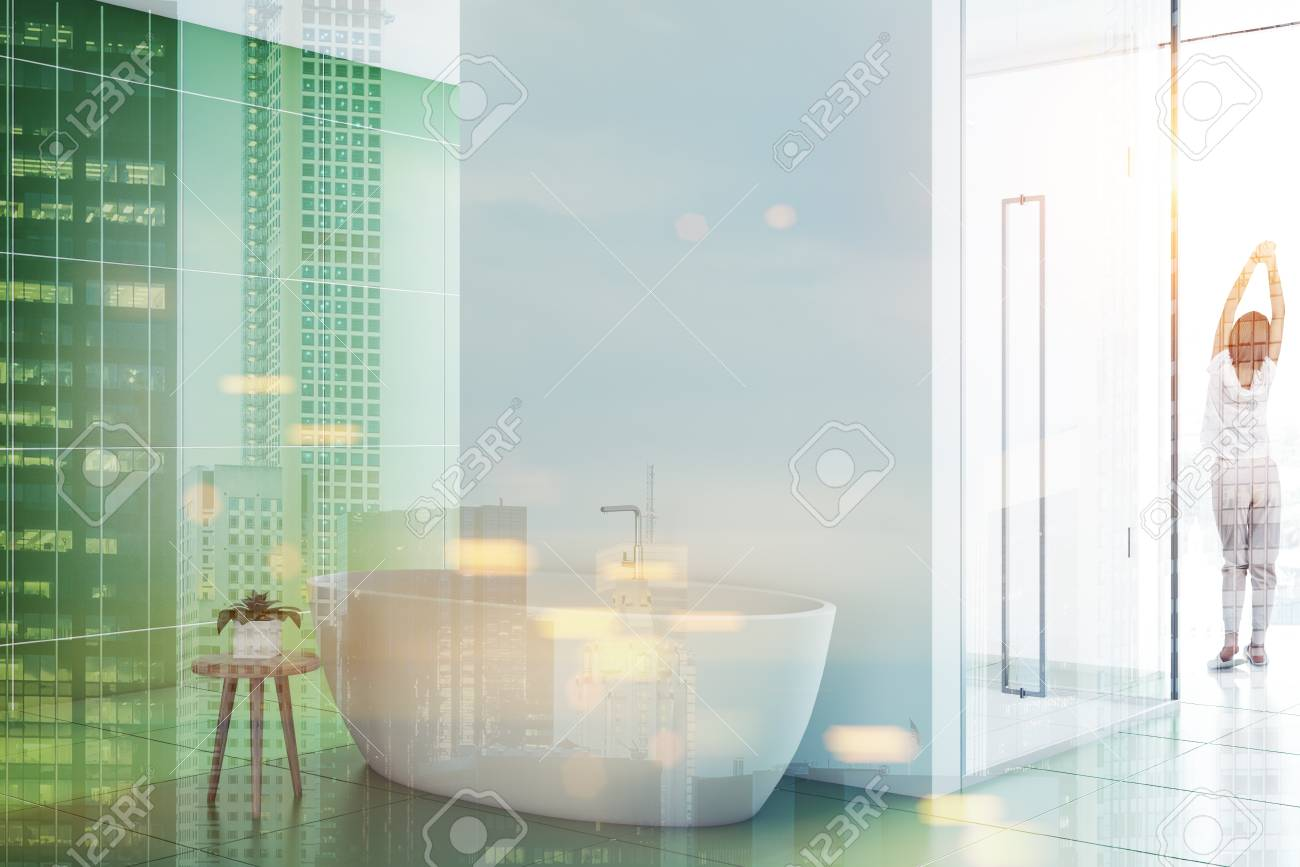 Woman In A Green Tile Bathroom Interior With A Nice White Tub ...