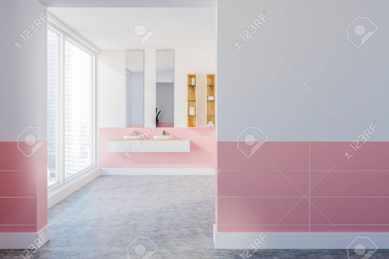 Double Bathroom Sink Standing On A White Shelf In A White And Pink