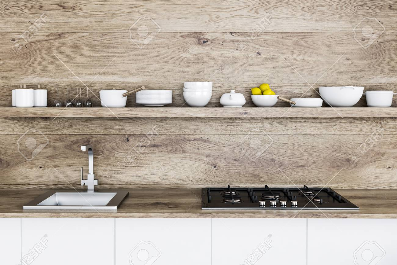 Wooden kitchen countertop with a sink and a cooker. A long shelf..