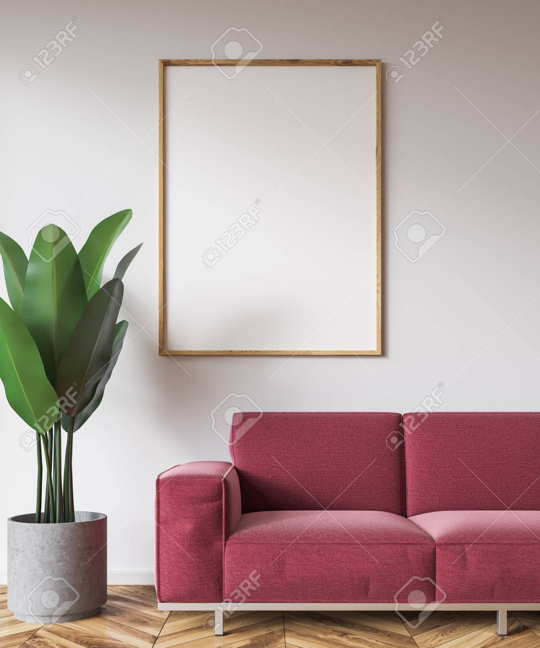 Wooden frame vertical poster hanging above a dark red couch in..