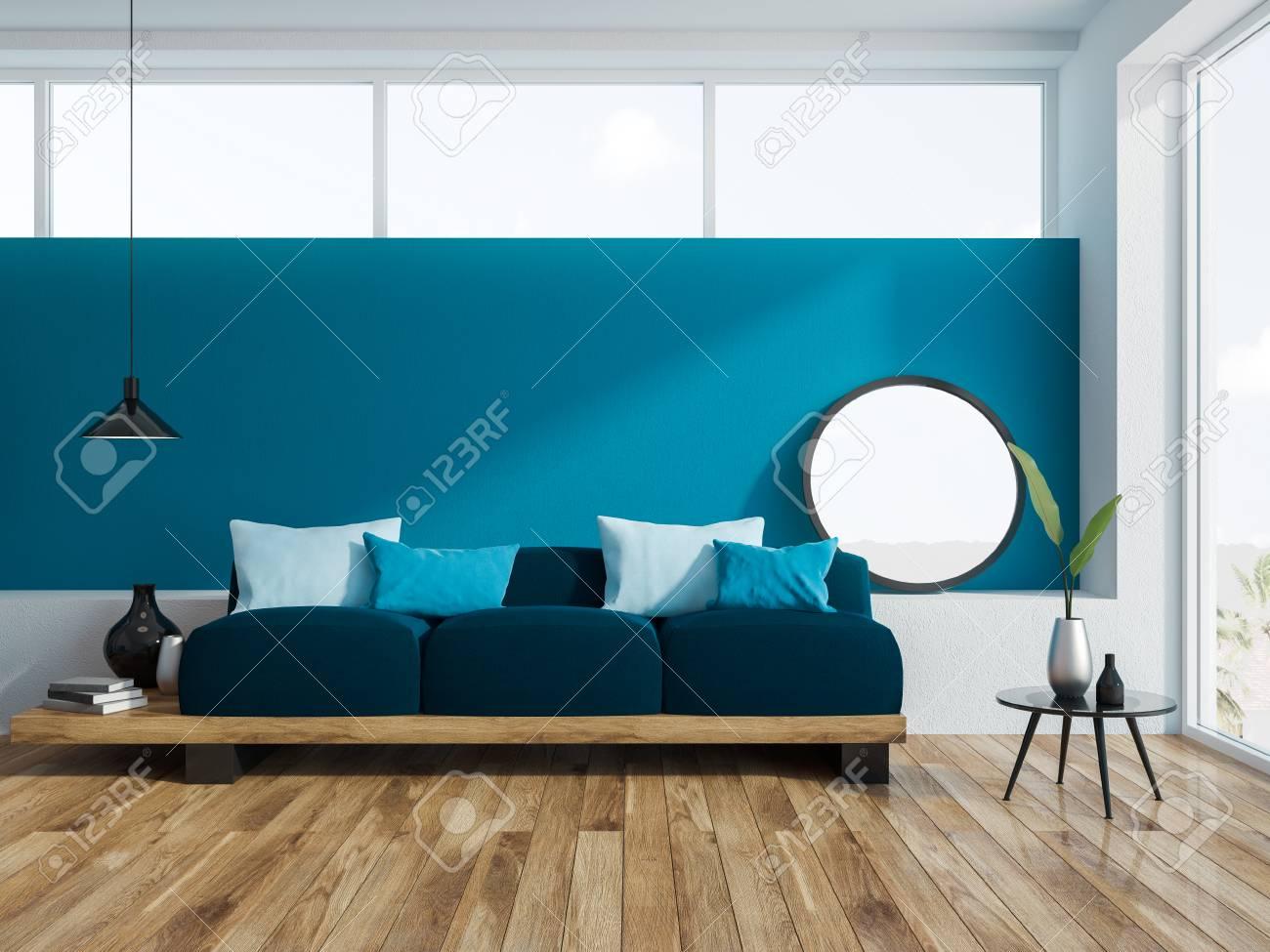 Awe Inspiring Blue Living Room Interior With A Wooden Floor A Loft Window Evergreenethics Interior Chair Design Evergreenethicsorg