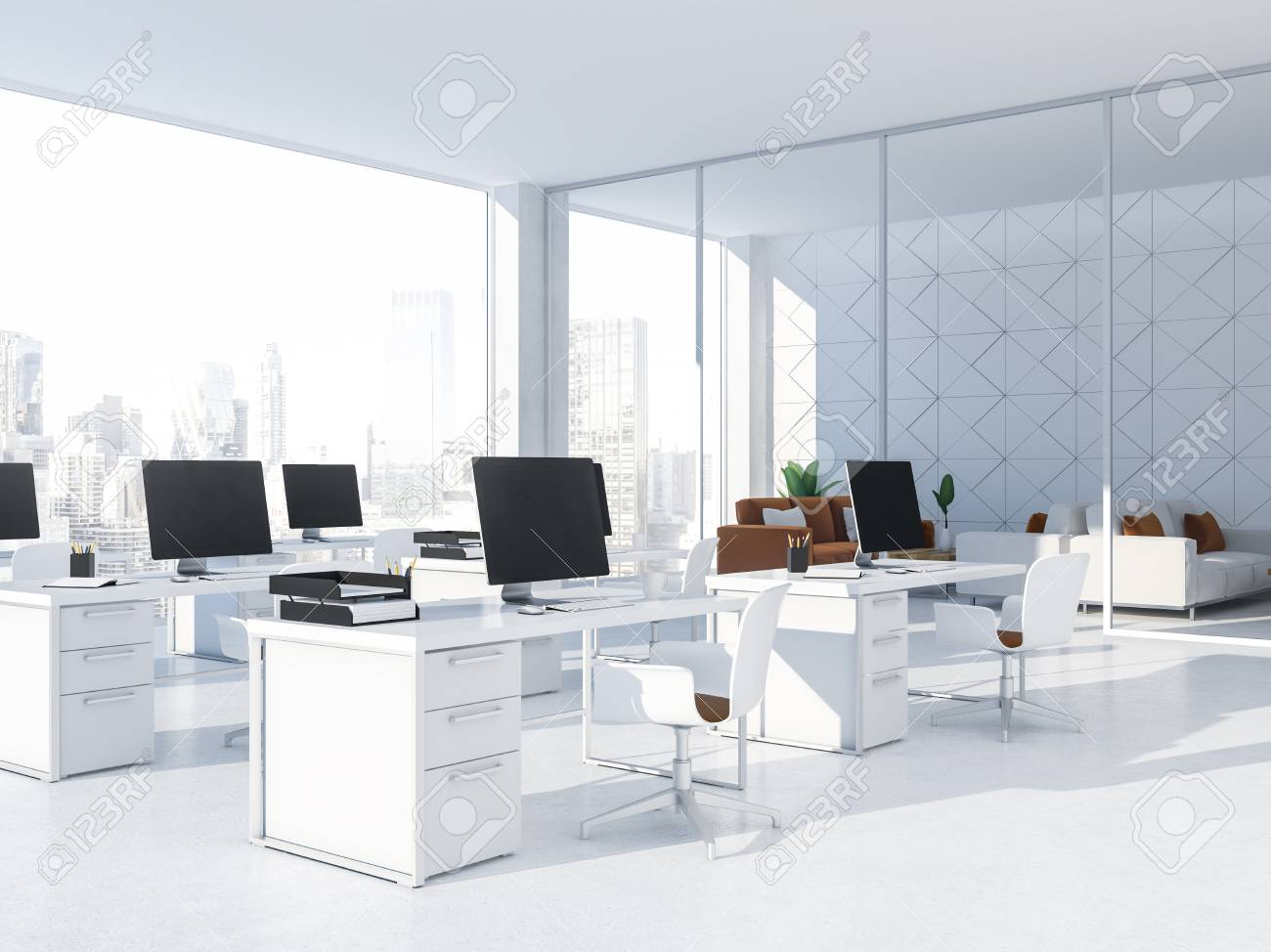 Modern white office interior with rows of white computer desks..