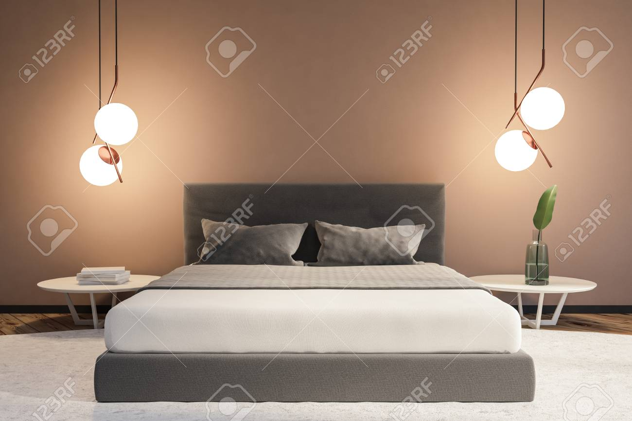 Modern bedroom interior with beige walls, a white carpet with..