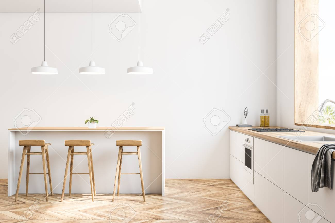 Interior of white kitchen with wooden floor, big window and white..