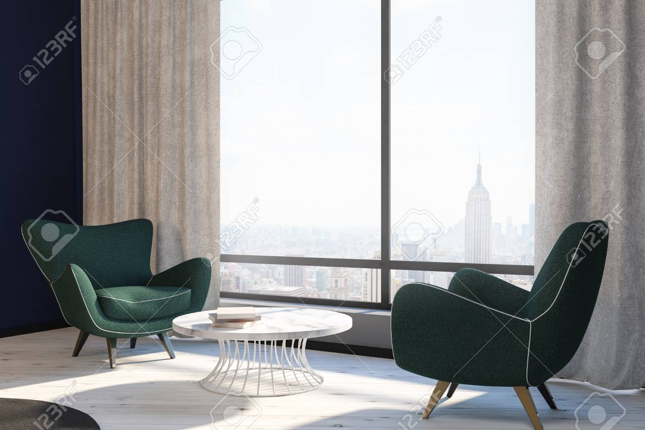 Side view of modern living room interior with two green armchairs..