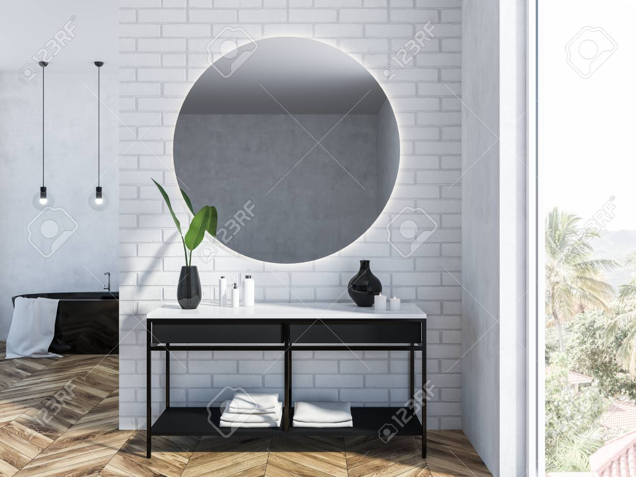 White Brick Bathroom Interior With A Black Bathtub A Round Mirror Stock Photo Picture And Royalty Free Image Image 109249448