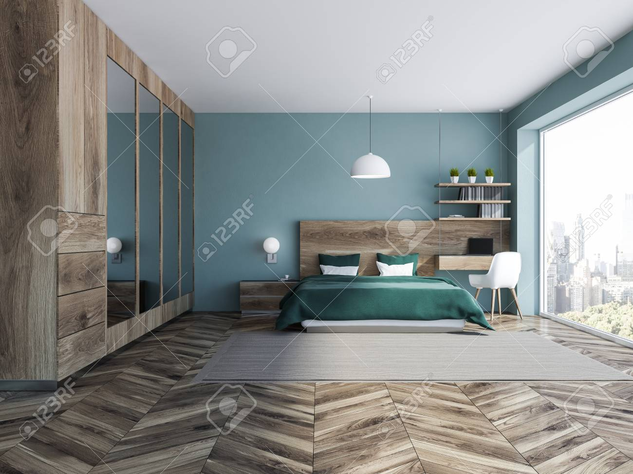 Interior of stylish bedroom with blue walls, wooden floor, green..