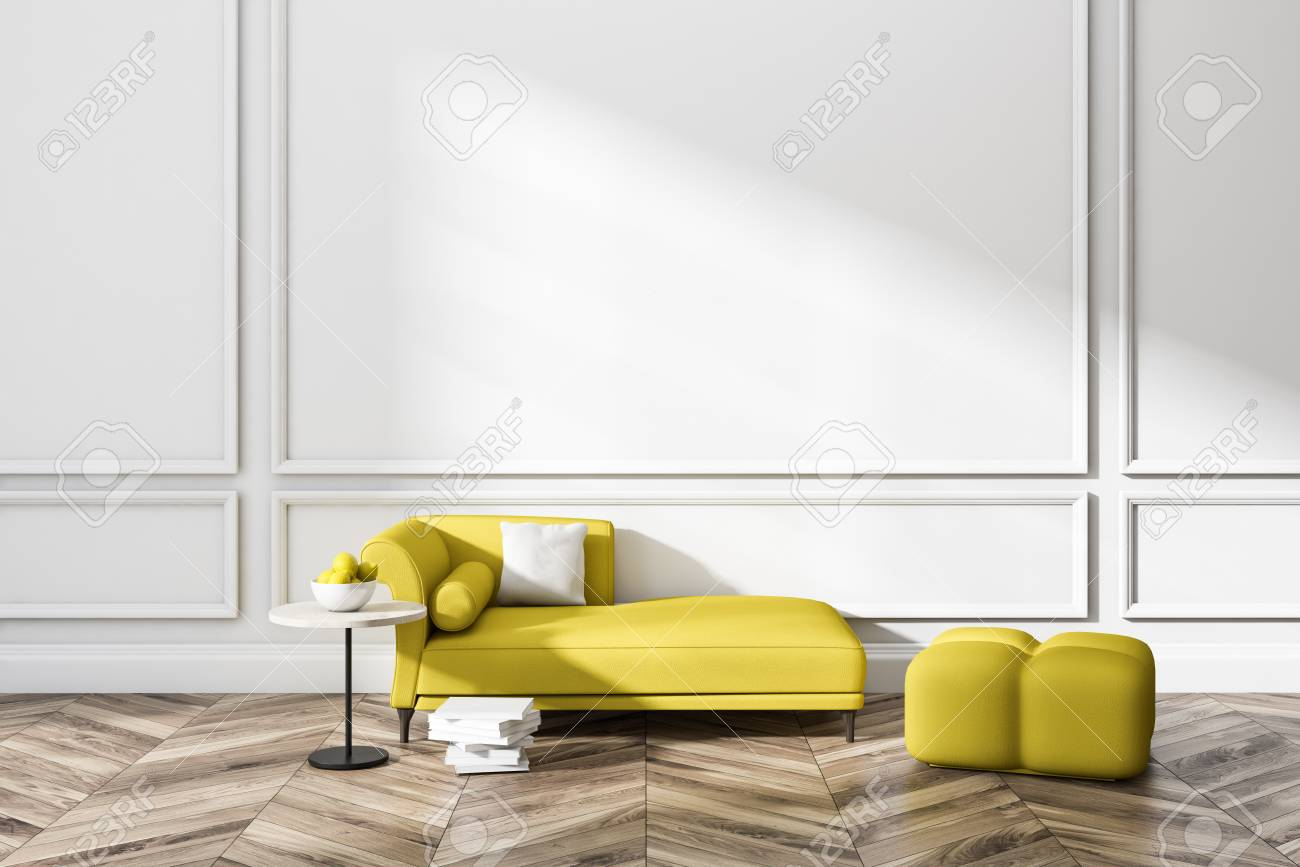 Minimalistic white living room interior with wooden floor yellow sofa and armchair and a coffee