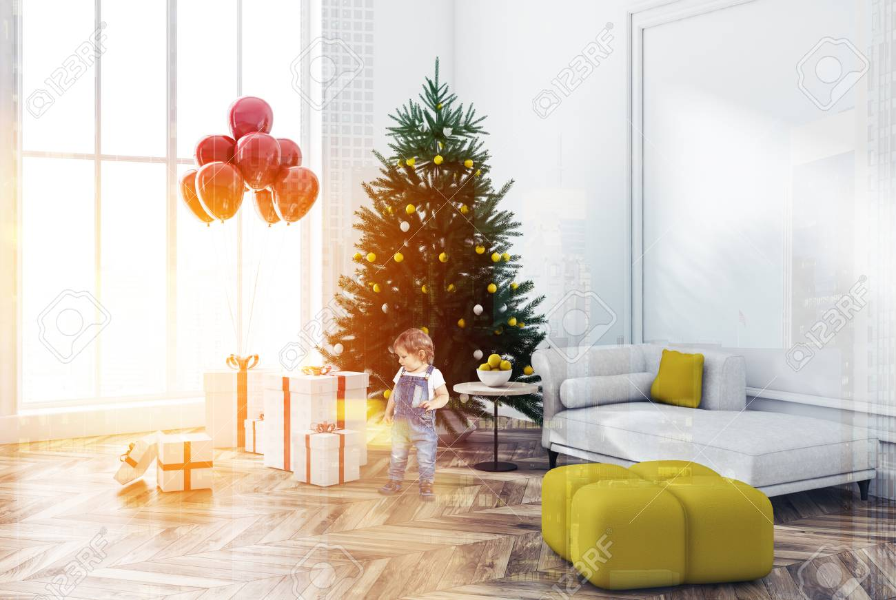 Cute Living Rooms | Cute Little Boy Looking At Presents In White Wall Living Room Corner