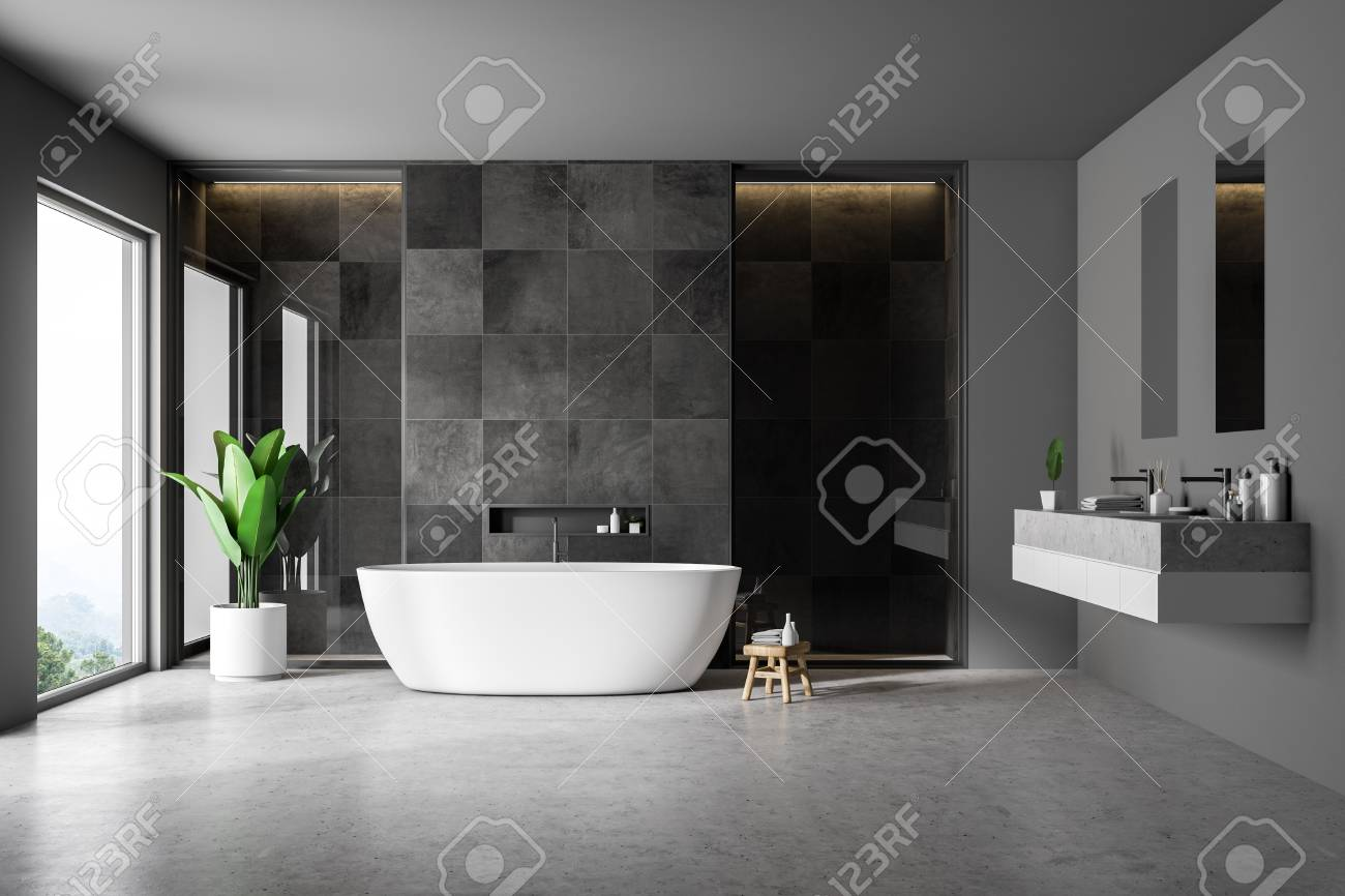 Modern bathroom interior with black tile walls concrete floor
