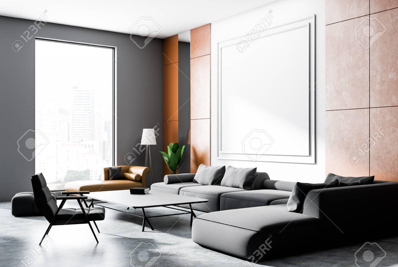 Gray and orange wall living room corner with concrete floor,..