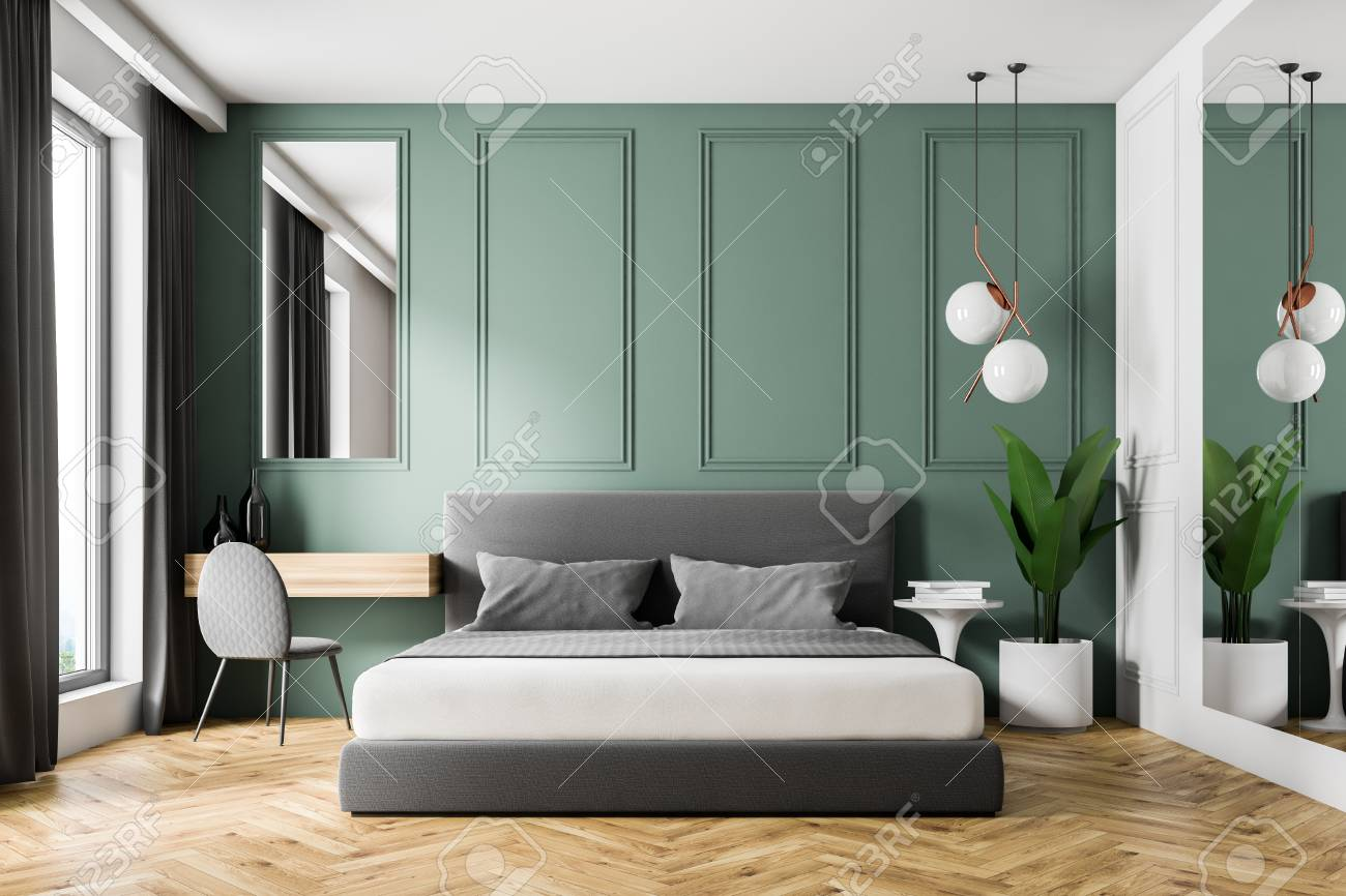 Interior of modern bedroom with green walls, wooden floor, gray..