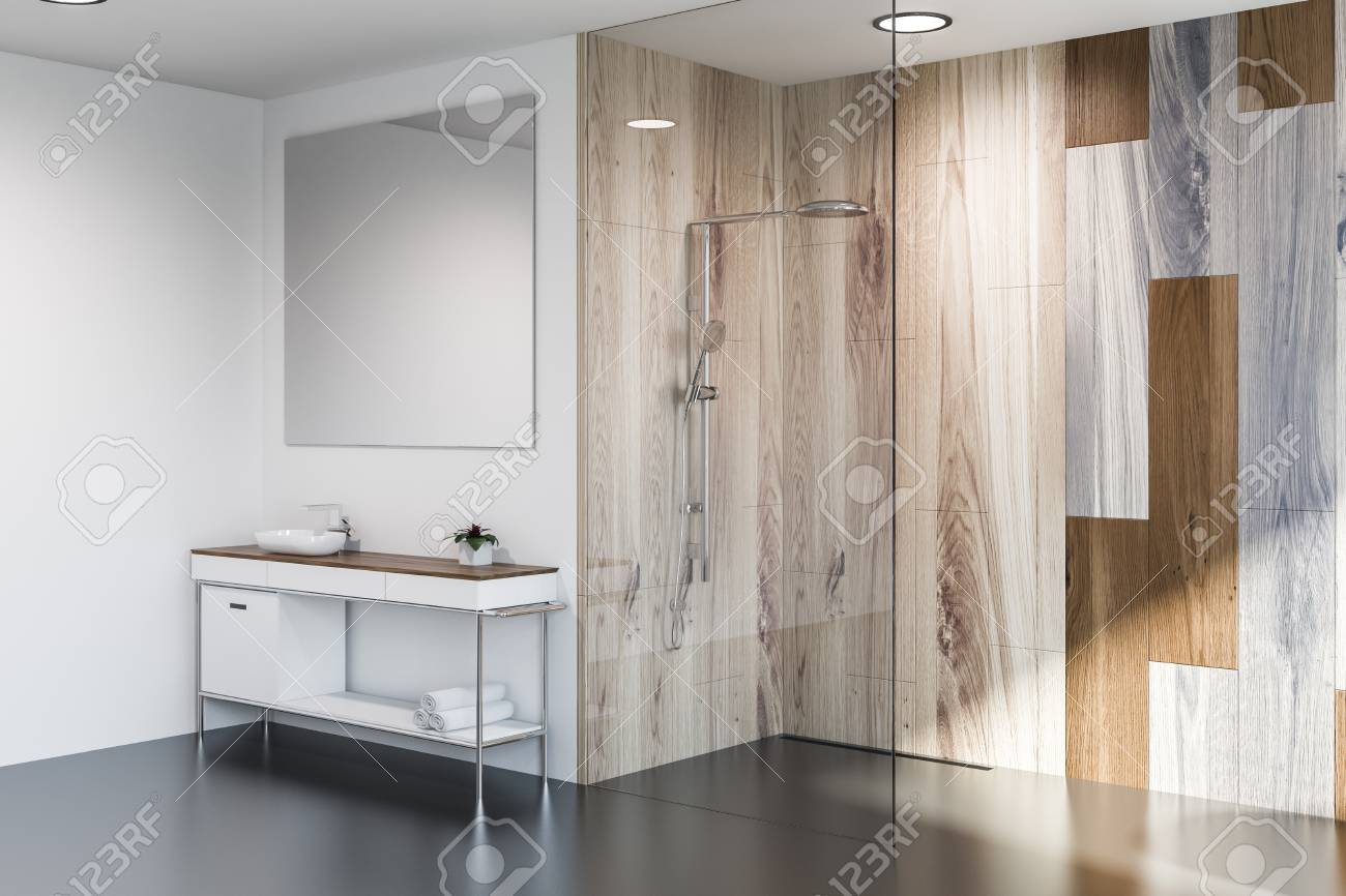 . Modern bathroom corner with gray and wooden walls  sink with