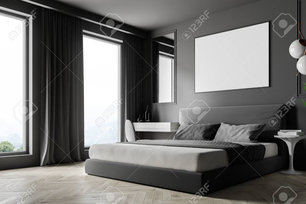 Corner of modern bedroom with gray walls, wooden floor, gray..