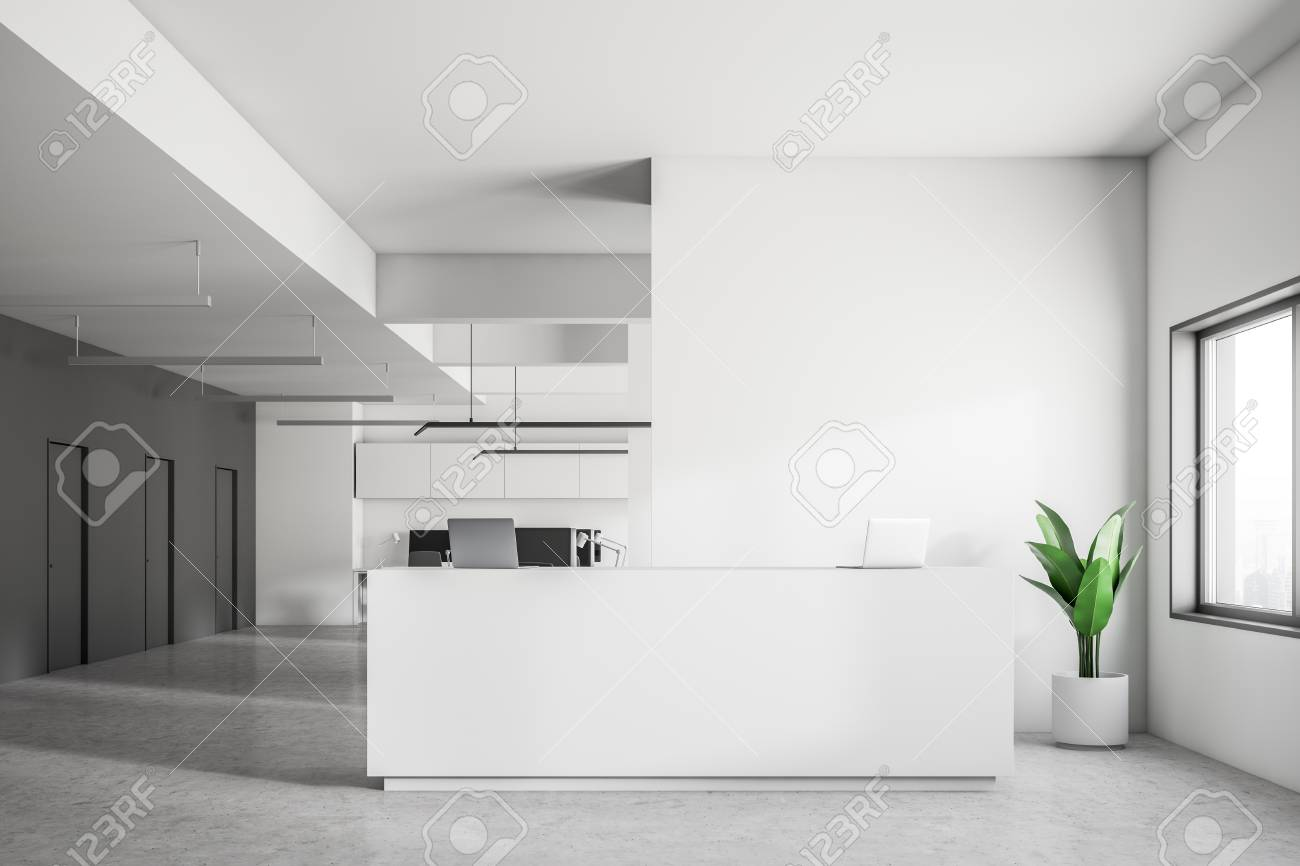 White reception desk with two laptops standing in modern company..