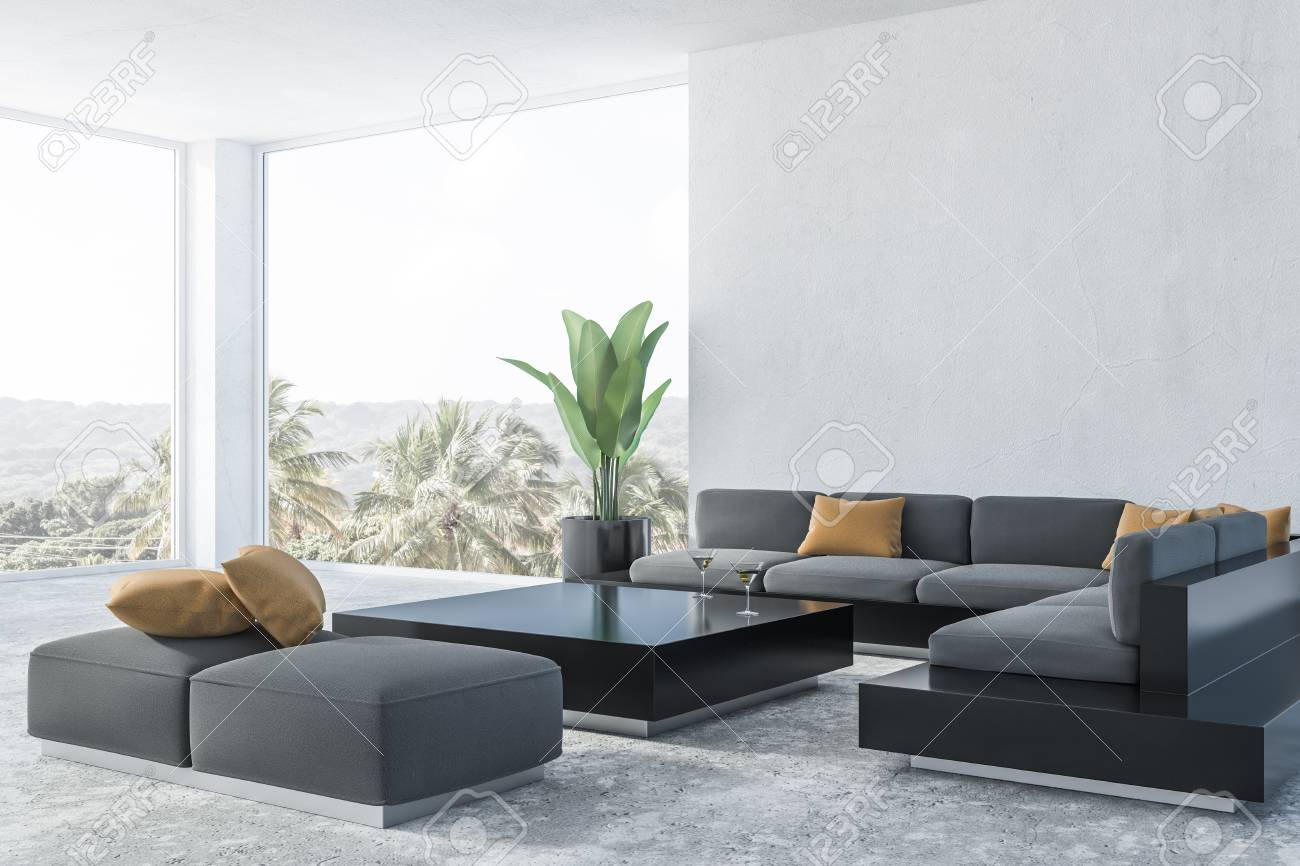 Modern living room corner with white walls, concrete floor, panoramic..