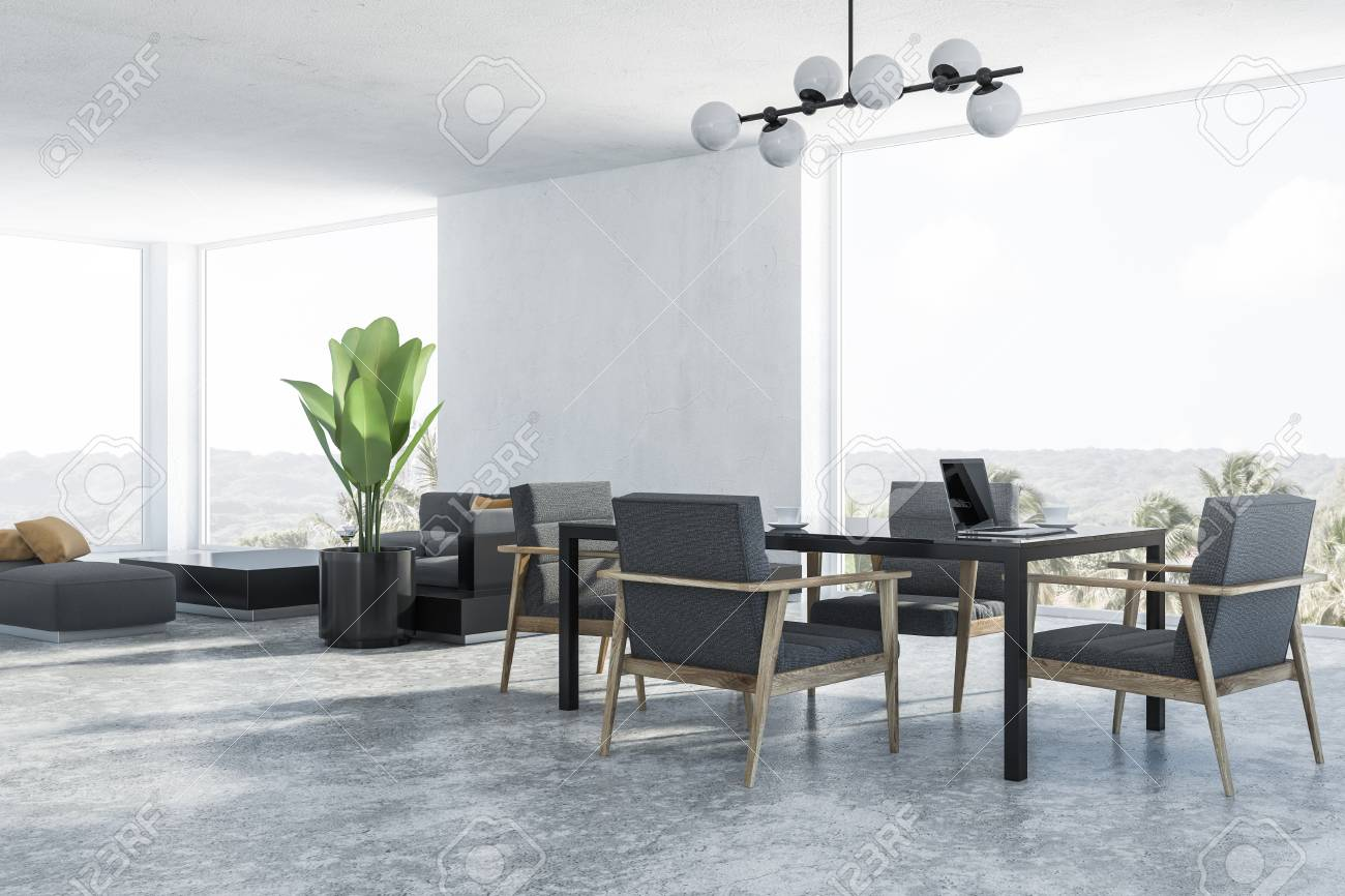 Corner Of Modern Dining Room And Living With White Walls Concrete Floor Black