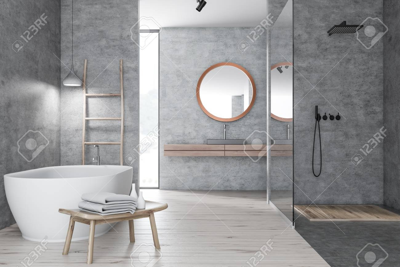 Interior Of Modern Bathroom With Concrete Walls, Wooden Floor, Shower With Glass  Wall,